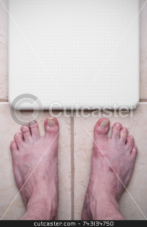 Ugly feet and scale stock photo, Ugly feet getting ready to step on a bathroom scale by Vince Clements