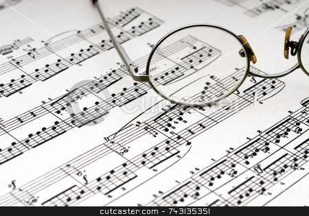 Reading glasses on sheet music stock photo, Old reading glasses resting on old sheet music by Vince Clements