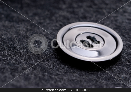 Black button stock photo, Macro of a button on a black coat by Vince Clements