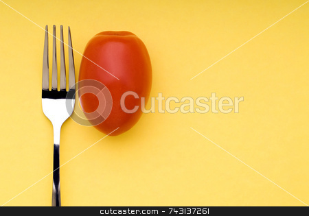 Fork and Tomato on yellow stock photo, Snappy image of a fork and a tomato on a bright yellow background by Vince Clements