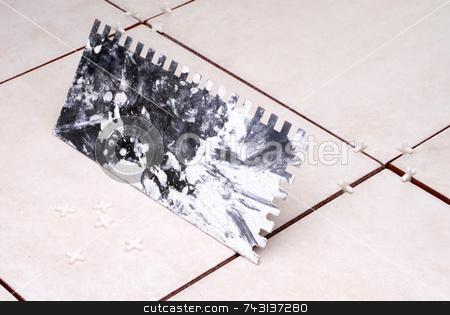 Installing ceramic tile stock photo, Installing ceramic tile by Vince Clements