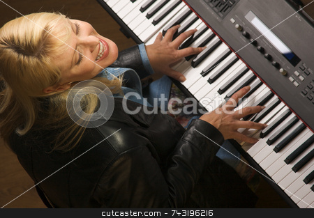 Femal Musician Performs stock photo, Femal Musician Sings While Playing Digital Piano by Andy Dean