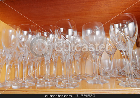Crystal Glasses stock photo, Crystal wine glasses arranged in a cupboard by Georgios Alexandris