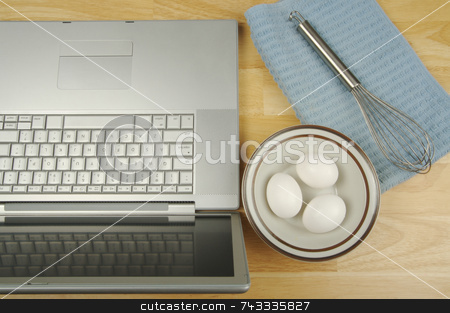 Laptop, eggs and mixer  stock photo, Laptop, eggs and mixer - online research for cooking and recipe information. by Andy Dean