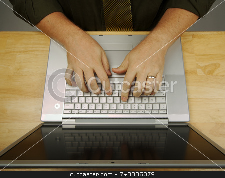 Man Using Laptop stock photo, Man Using Laptop Overhead Image by Andy Dean