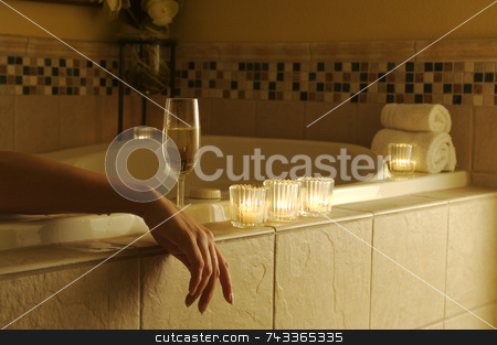 Woman In Bath stock photo, Beautiful Woman in bubble bath with sparkling wine and candles surrounding her. by Andy Dean