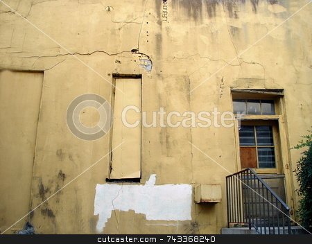 Grunge Wall stock photo, Grunge wall with a door in a  back alley of a store. by Jack Schiffer