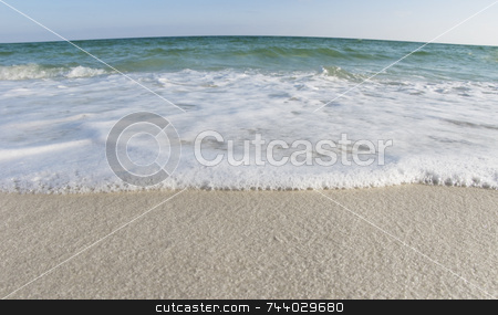 White Sand Beach stock photo, Ocean and white sand close up by A Cotton Photo