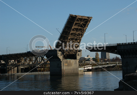 Draw bridge stock photo, An old draw bridge crossing the river in Portland Oregon by Tim Markley