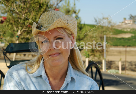 Cute Cowgirl in The Country stock photo, Cute Cowgirl in The Country wearing cowboy hat. by Andy Dean