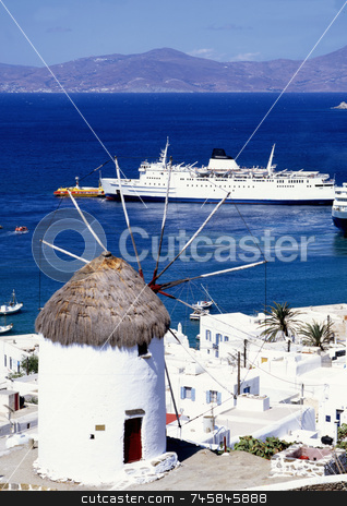 Mykonos Bay stock photo, A windmill overlooking the harbour of Mykonos a greek island by Paul Phillips