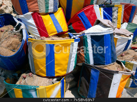 Fishing bags stock photo, Colourful fishing bags in Cyprus by Paul Phillips