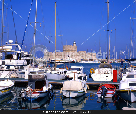 Old Port stock photo, Boats moored in harbour of Rhodes, greece, with old fort in background by Paul Phillips