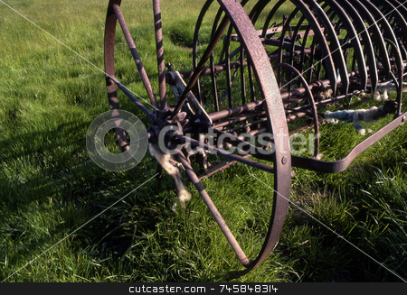Old Plough stock photo, An old rusty plough in spring field in England by Paul Phillips