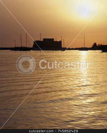 Medieval Castle stock photo, Medieval Castle of Paphos, Cyprus at sunset with the sea turning to liquid gold by Paul Phillips