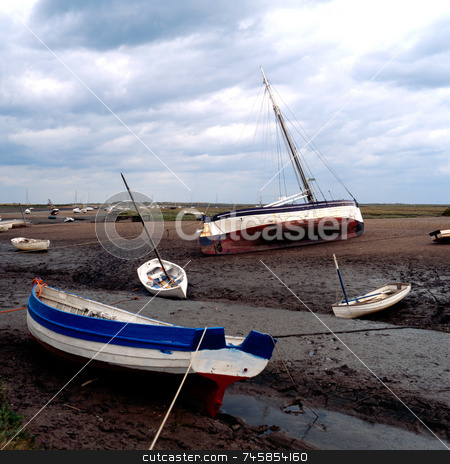 Low Tide stock photo, Boats left on the bed of an estuary after the tide has gone out by Paul Phillips