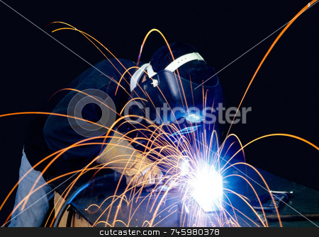 Sparkey stock photo, A welder working with sparks flying around by Paul Phillips