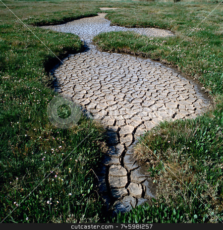 Dry Field stock photo, Deep cracks left in a field after a period of drought by Paul Phillips
