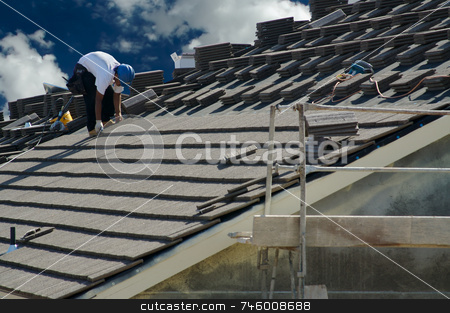 Roofer Laying Tile stock photo, Roofer Laying Tile Shingles on a New Home by Andy Dean