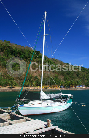 Sail boat stock photo, Sail boat docked at a pier of a resort by Jonas Marcos San Luis