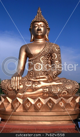 Another golden buddha stock photo, Statue of a golden buddha against a blue sky by Jonas Marcos San Luis