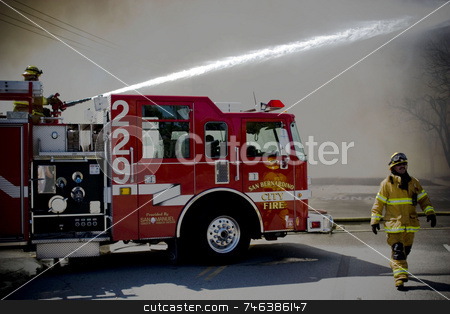 FIRE stock photo, Brett Benham/Brooks Institute ??? 2008  A San Bernardino firefighter passes by as another hoses down a group of abandoned buildings in Colton, Calif., on March 22, 2008 after it caught on fire. The cause of the fire is not known as of Saturday, March 22, and no injuries were reported. by Brett Benham
