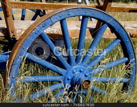 Old Blue Wheel stock photo, An old wooden wheel,  painted in rich blue by Tom and Beth Pulsipher