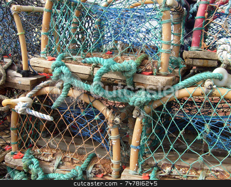 Lobster Pots stock photo, Portrait of some lobster pots seen in detail in harbor. by Martin Crowdy