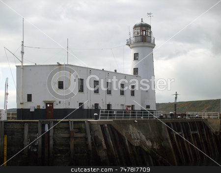 WWhite lighthouse stock photo, White lighthouse at harbor mouth by Martin Crowdy