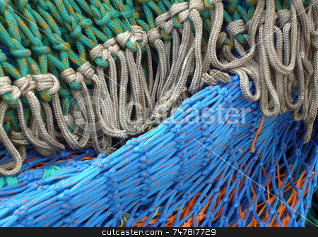 Fishing nets stock photo, Fishing nets seen in close up detail. by Martin Crowdy