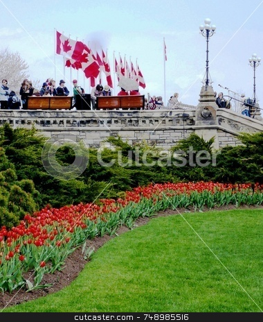 Parliament Hill Flags n' Flowers stock photo, The front steps below Canada's Parliament Building Centre Block where flags have been set up awaiting a special address by her Excellency the Right Honorable  Micha? by Michael Ge . . . .