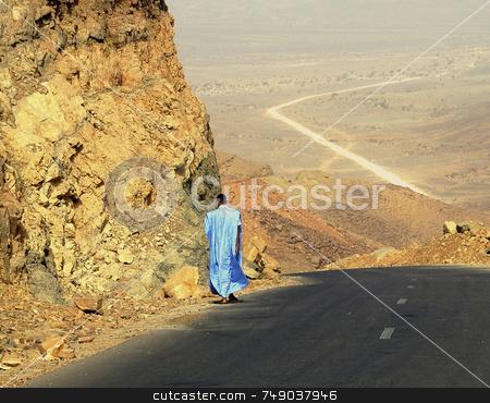 Alone In The Desert stock photo, Mauritani men walking alone in the desert by Kobby Dagan