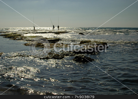 Ceasarea Beach stock photo, Fishermens in the mediteranian sea in ceasarea israel by Kobby Dagan