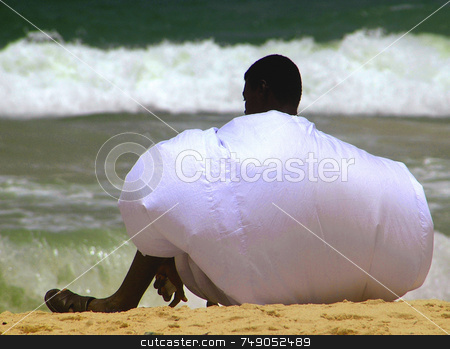 Mauritanian Man stock photo, Mauritanian man settled in the beach with traditional clothes by Kobby Dagan