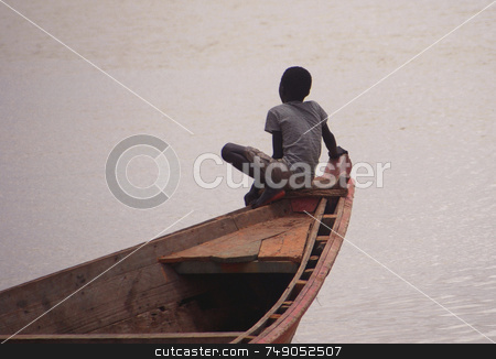 On the edge stock photo, Child on a boat at Sengal river by Kobby Dagan