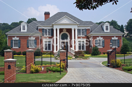 Brick House stock photo, Large brick house behind iron gate by Darryl Brooks