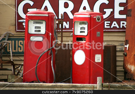 Price of Gas stock photo, Two red vintage gas pumps by Darryl Brooks