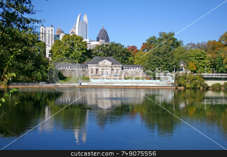 City Lake 3 stock photo, Poolhouse and city skyline across lake in park by Darryl Brooks