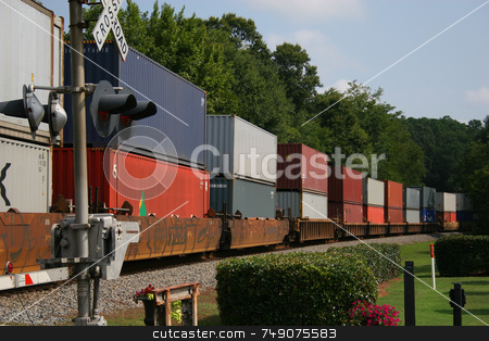 Freight Train stock photo, Freight Train across railroad crossing by Darryl Brooks