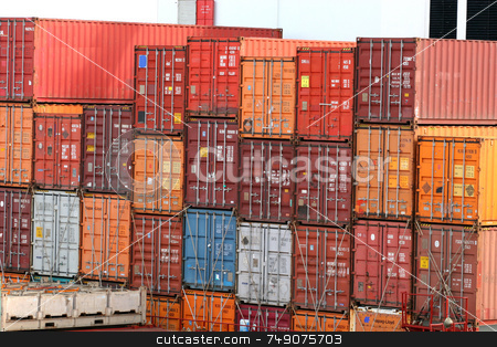 Stack of Freight stock photo, Stack of colorful freight containers on a dock by Darryl Brooks