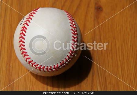 Baseball stock photo, A slightly Worn baseball on wood background by Darryl Brooks