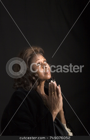 Spiritual African American woman stock photo, A spiritual  woman looking to heaven and praying by Darryl Brooks