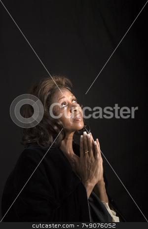 Spiritual African American woman stock photo, A spiritual  woman looking to heaven and praying by Darryl Brooks