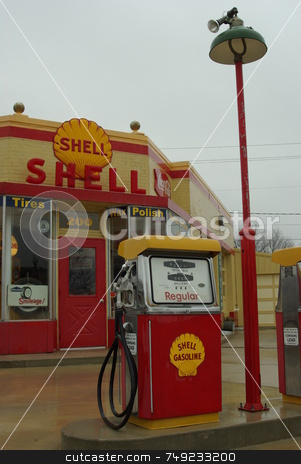Old Shell Gas Station stock photo, This old Shell Gas Station on main street in Waverly, Iowa offers a step back in time to the 1970s when gas cost less than one dollar ($1) a gallon.  The old gas station, which has been restored with care to its sparkling former glory, is now a museum and is open on special occasions or by private appointment . by Dennis Thomsen