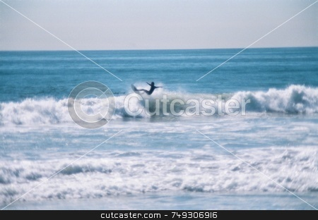 Flying surfer stock photo, A surfer flying on the top of a wave by Rob Wright