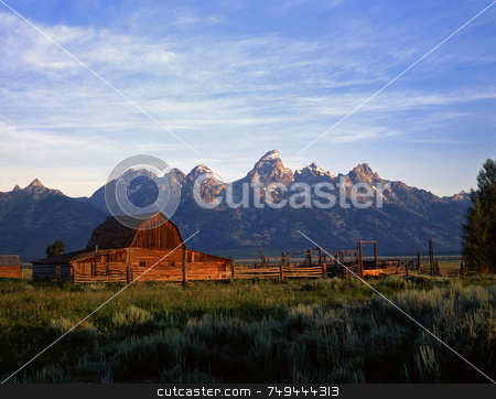 Teton Ranch Two stock photo, A barn and corral at the base of the Teton Mountain Range in Grand Teton National Park, Wyoming. by Mike Norton