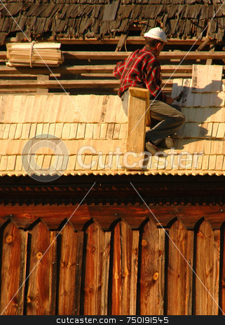 Builder stock photo, Men fixing the roof in ukranian village house by Kobby Dagan