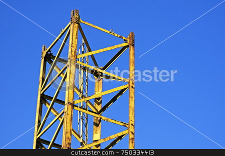 Part of a crane stock photo, Yellow structure part against a blue sky by Massimiliano Leban