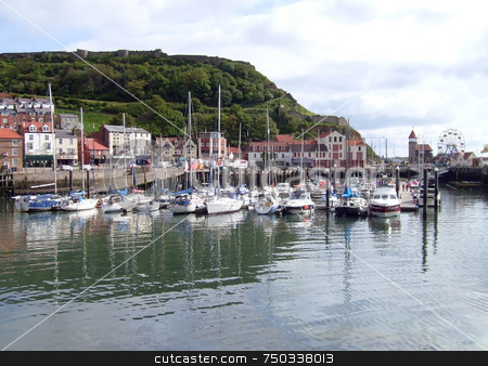 Yacht marina in Scarborough stock photo, Yacht marina in Scarborough harbor, with castle in background, U.K. by Martin Crowdy