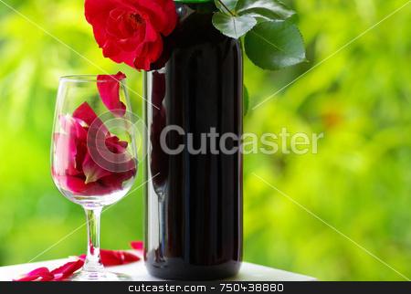 Petals of rose in a glass . stock photo, Petals of rose in a glass of red wine. by Inacio Pires